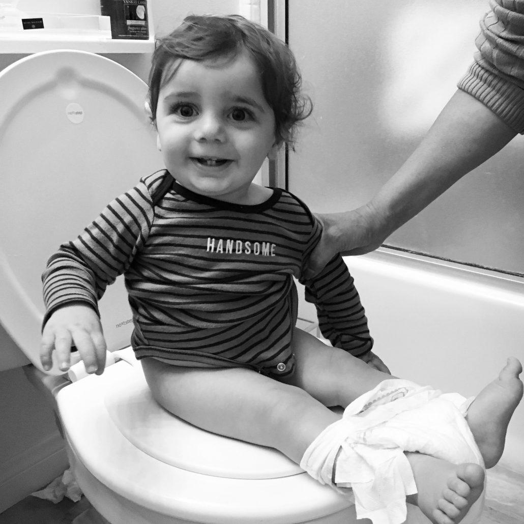 baby boy using the potty - Learn Eat Sleep