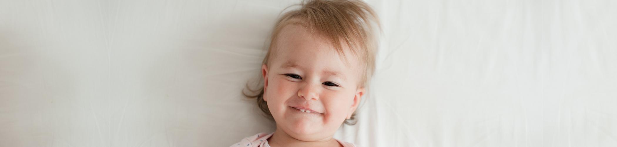 smiling baby - Learn Eat Sleep