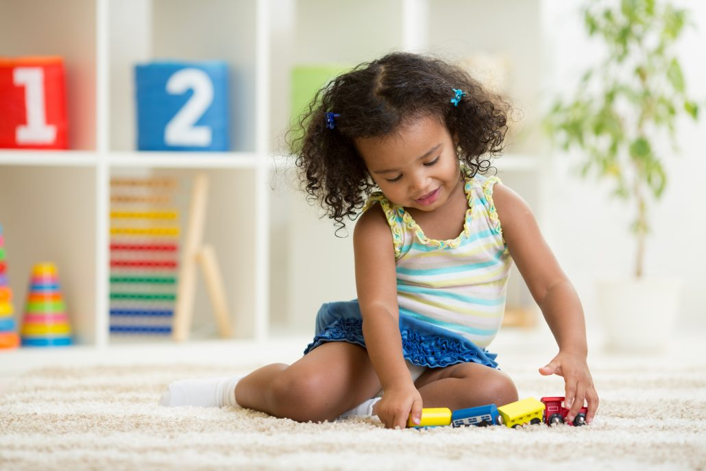little girl playing with trains - Learn Eat Sleep