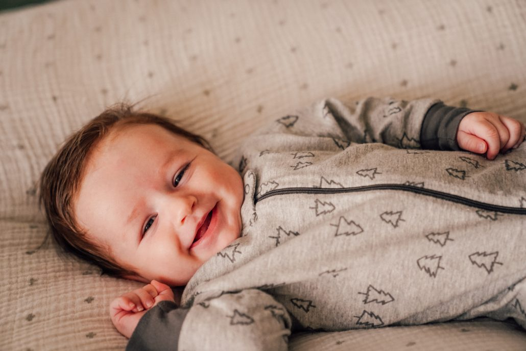 smiling happy baby boy - Learn Eat Sleep