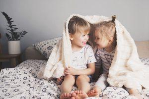 siblings playing under blankets - Learn Eat Sleep