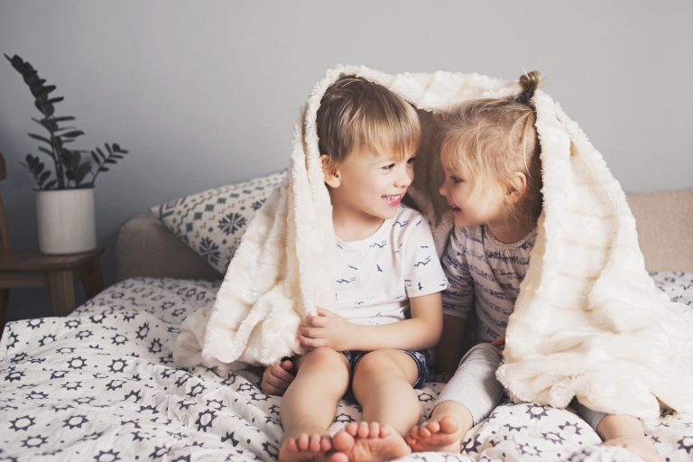 siblings playing under blankets - Learn Eat Sleep