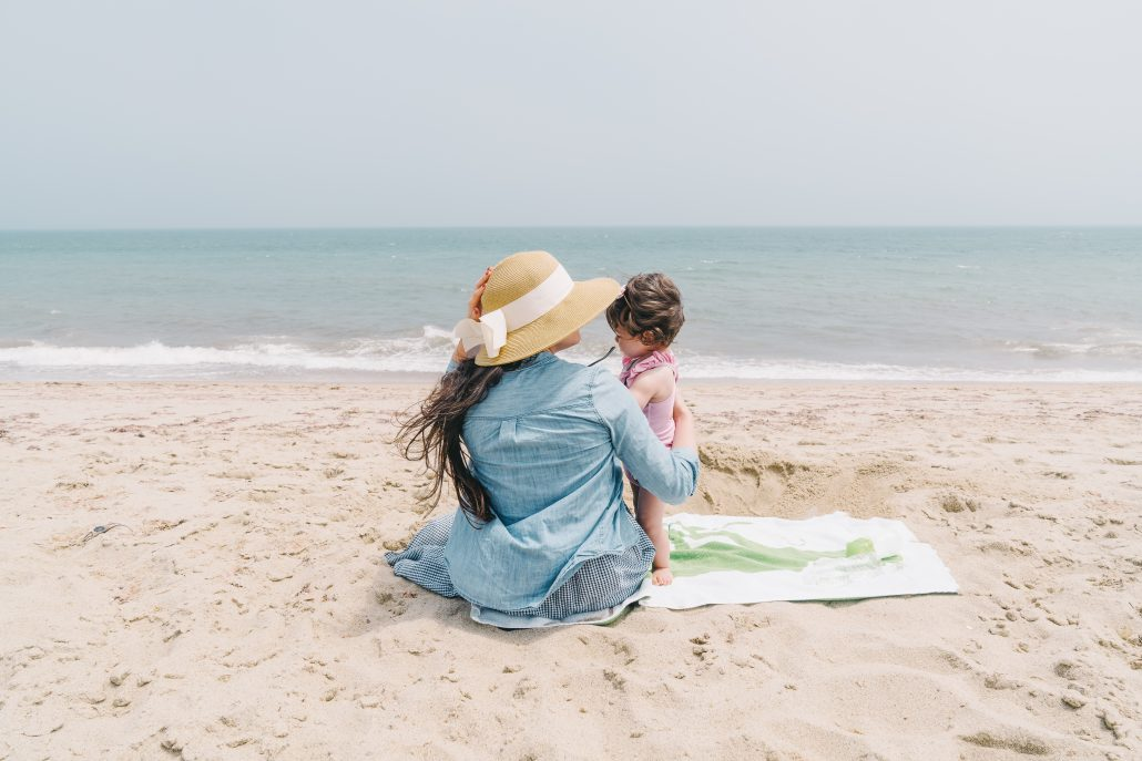 mom with her baby at the beach - Learn Eat Sleep