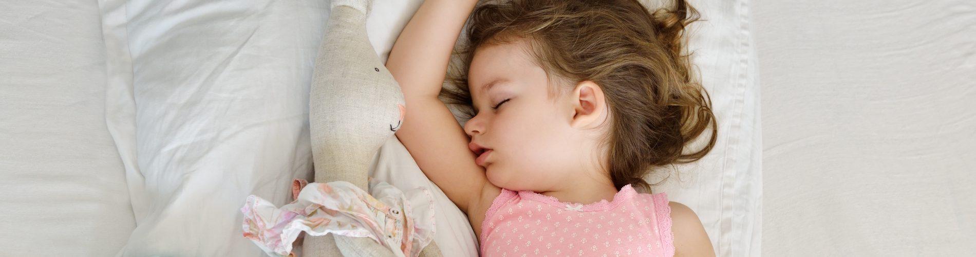little girl sleeping with stuffed rabbit - Learn Eat Sleep